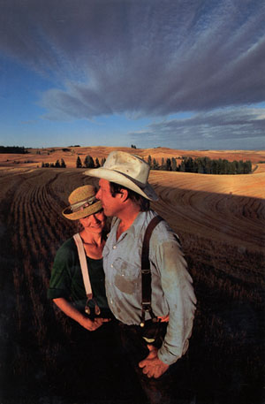 MaryJane and Nick in tilled fields on the Palouse