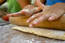 Hands rolling out the BakeOver crust